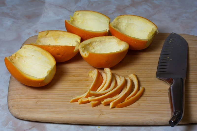 Cut the orange peels with a knife